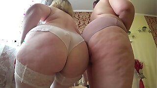 Sexual foreplay of a handful of mature lesbians with fat asses, perishable undressing and caress.