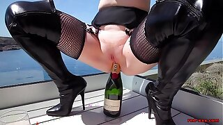 Mature Red XXX fucks a champagne bottle broadly