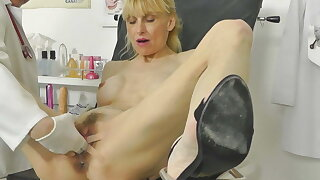 Hot MILF caught squirting in gynochair with stifling cam